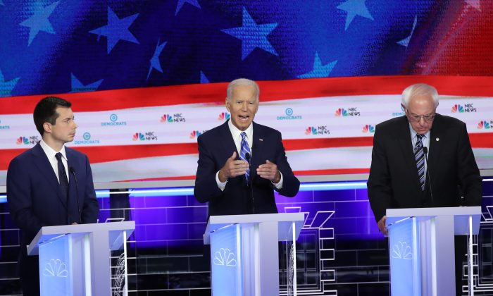 Democratic presidential candidates (L-R) South Bend, Indiana Mayor Pete Buttigieg, former Vice President Joe Biden and Sen. Bernie Sanders (I-VT) take part in the second night of the first Democratic presidential debate on June 27, 2019 in Miami, Florida. (Drew Angerer/Getty Images)