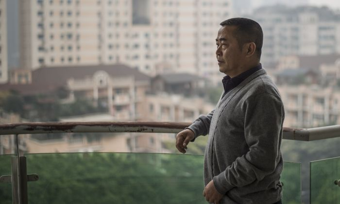 Chinese dissident Huang Qi poses in his apartment in Chengdu, Sichuan province on January 22, 2015. (FRED DUFOUR/AFP/Getty Images)