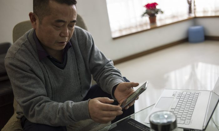 Chinese dissident Huang Qi poses in his apartment in Chengdu, Sichuan Province on Jan. 22, 2015. (Fred Dufour/AFP/Getty Images)