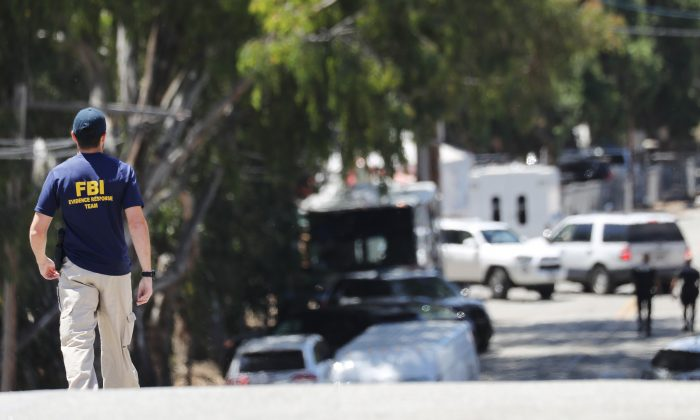 An FBI agent walks toward the site of the Gilroy Garlic Festival in Gilroy, Calif., on July 29, 2019.(Mario Tama/Getty Images)