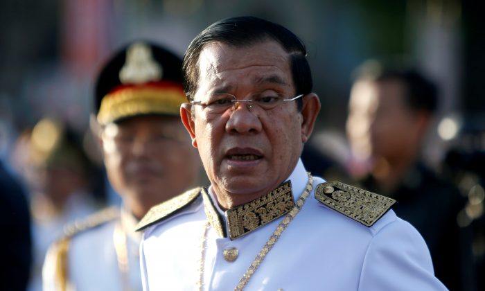Cambodia's Prime Minister Hun Sen arrives at the Independence Monument to attend celebrations marking the 65th anniversary of the country's independence from France, in Phnom Penh, Cambodia on Nov. 9, 2018. (Samrang Pring/Reuters)