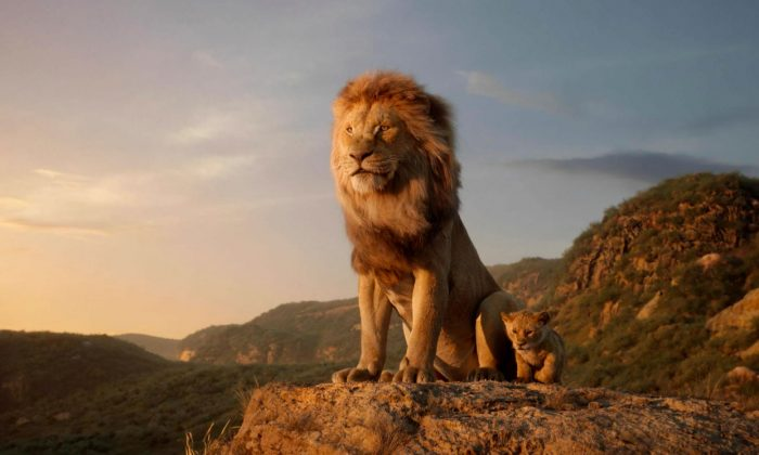 "Mufasa (L) voiced by James Earl Jones, and young Simba, voiced by JD McCrary, in a scene from ""The Lion King."" (Disney via AP)"