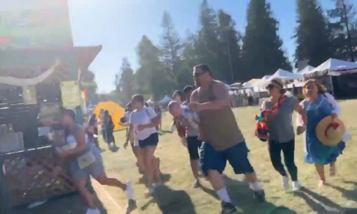 People run as an active shooter was reported at the Gilroy Garlic Festival, south of San Jose, California, U.S., July 28, 2019 in this still image taken from a social media video. (Courtesy of Twitter @wavyia via Reuters)