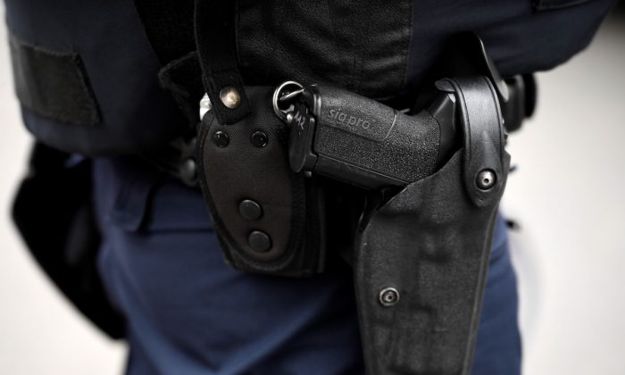 A stock photo shows a police officer wearing a SIG-Sauer pistol. (Lionel Bonaventure/AFP/Getty Images)