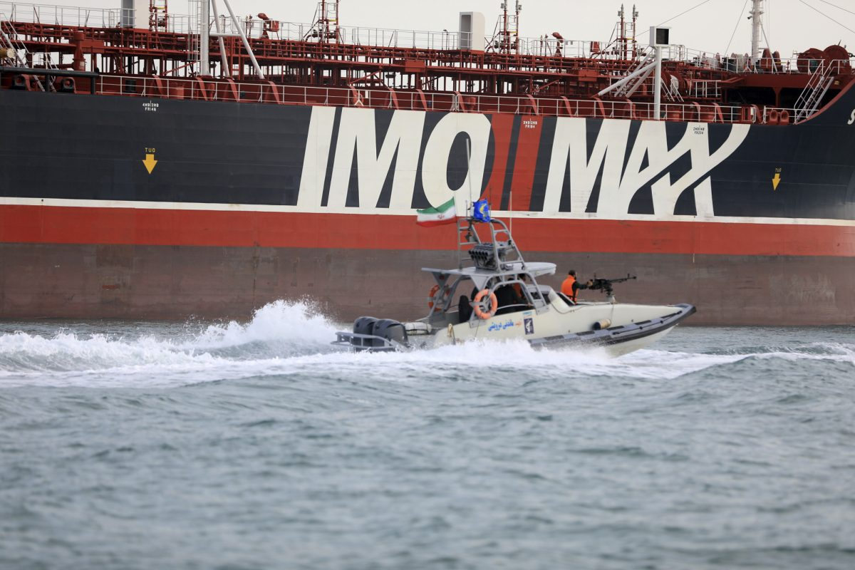 A speedboat of the Iran's Revolutionary Guard moves around a British-flagged oil tanker