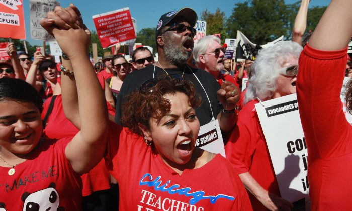 Striking Chicago teachers and their supporters attend a rally at Union Park September 15, 2012 in Chicago, Ill. Scott Olson/Getty Images)