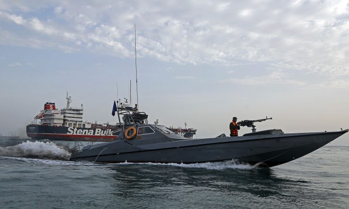 A picture taken on July 21, 2019, shows Iranian Revolutionary Guards patrolling around the British-flagged tanker Stena Impero. (Hasan Shirvani/AFP/Getty Images)