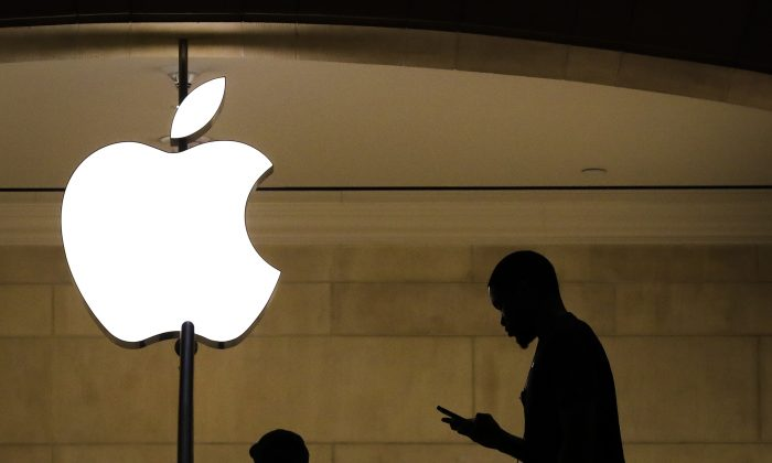 A man checks his phone in an Apple retail store in Grand Central Terminal, in New York City, on Jan. 29, 2019. (Drew Angerer/Getty Images)
