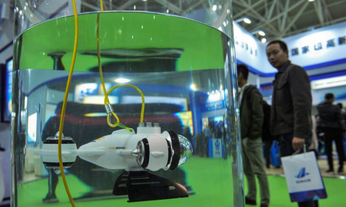 A visitor looks at an underwater robot during the Oceanology International China 2018 Expo in Qingdao, a city in eastern China's Shandong Province, on Oct. 23, 2019. (STR/AFP/Getty Images)