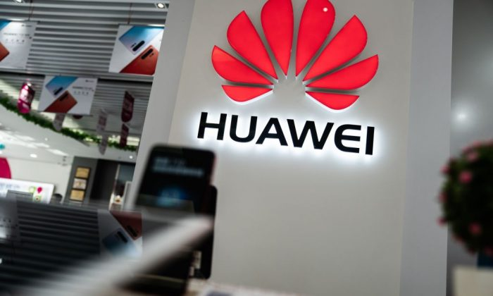 A Huawei logo is displayed at a retail store in Beijing on May 20, 2019. (Fred Dufour/AFP/Getty Images)