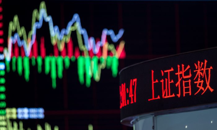 A board shows the stock movements inside the Shanghai Stock Exchange in the Lujiazui financial district of Shanghai, China on Sept. 22, 2015. (JOHANNES EISELE/AFP/Getty Images)