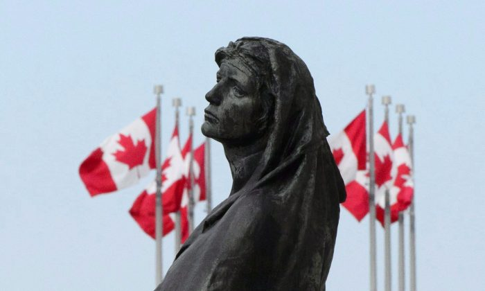 The statue of Veritas (Truth) is pictured in front of the Supreme Court of Canada in Ottawa on May 23, 2018. (Sean Kilpatrick/The Canadian Press)