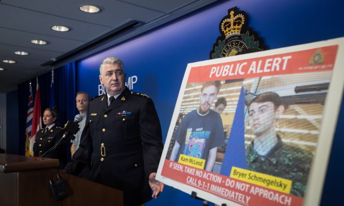 Security camera images of murder suspects Kam McLeod and Bryer Schmegelsky are displayed as RCMP Assistant Commissioner Kevin Hackett steps away from the podium after speaking during a news conference in Surrey, B.C., on July 23, 2019. (Darryl Dyck/The Canadian Press)