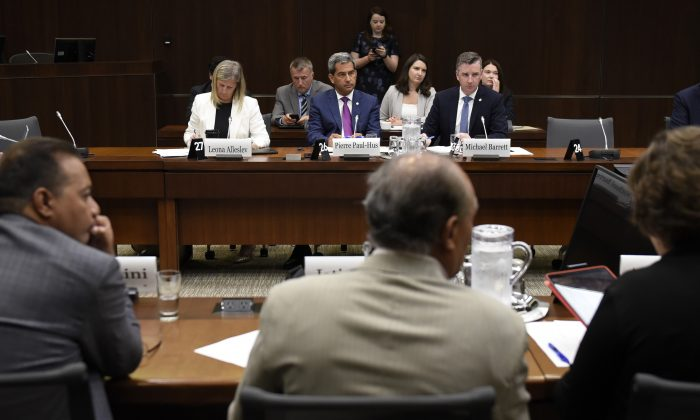 Conservative MPs Leona Alleslev, Pierre Paul-Hus and Michael Barrett sit across from Liberal MPs before an emergency meeting of the Standing Committee on Foreign Affairs and International Development to discuss a request to undertake a study of undue pressure on former career diplomats, in Ottawa on July 30, 2019. (Justin Tang/The Canadian Press)