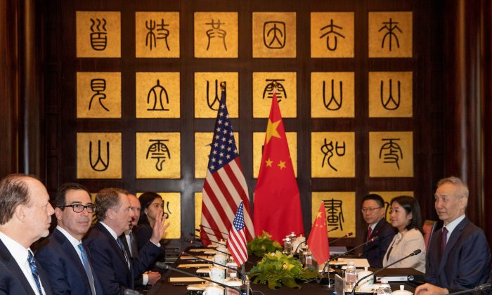 Chinese Vice Premier Liu He (at right) looks over as U.S. Trade Representative Robert Lighthizer (third from left) gestures near Treasury Secretary Steve Mnuchin (second from left) before the start of talks at the Xijiao Conference Center in Shanghai, China on July 31, 2019. (Ng Han Guan/Pool via Reuters)