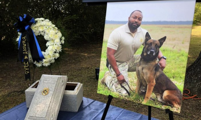 Alabama K-9 Jake, who died after coming into contact with a narcotic during a prison contraband search, was honored with a 21-gun salute and commendation from Gov. Kay Ivey at the Staton Kennel Complex in Elmore, Ala., on July 30, 2019. (Blake Paterson/AP Photo)
