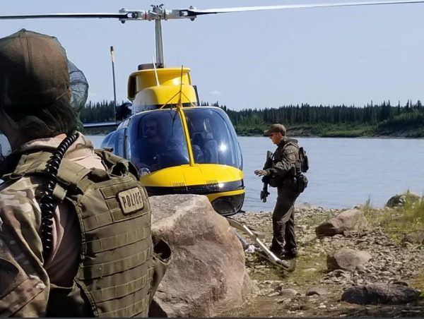 RCMP search an area near Gillam, MB. in this photo posted to their Twitter page on July 30, 2019. couple. (Twitter, Manitoba RCMP/ The Canadian Press)
