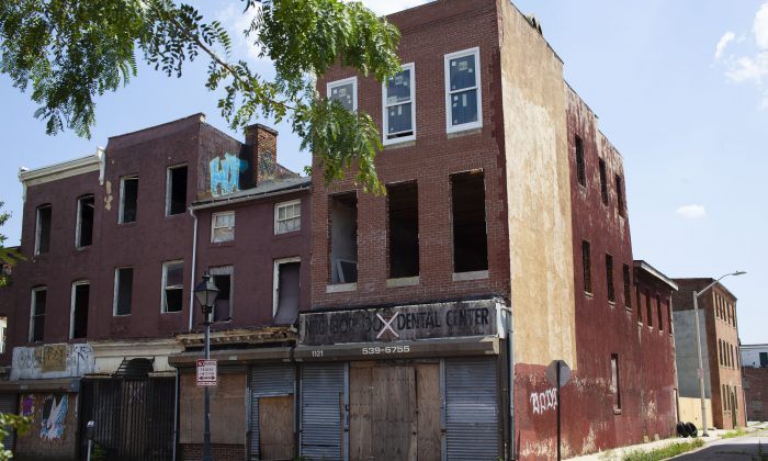 Buildings on a street in west Baltimore, Md., on July 30, 2019. (Petr Svab/The Epoch Times)