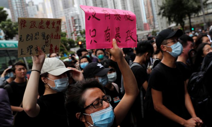 """Supporters gather outside the Eastern Courts to support the arrested anti-extradition bill protesters who face rioting charges, in Hong Kong, China on July 31, 2019. The placard reads, """"There is no thugs, only tyranny."""" (Tyrone Siu/Reuters)"""
