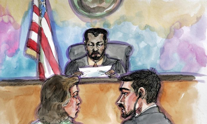 Terror probe defendant Hamid Hayat, right, and his attorney Wazhma Mojaddidi listen as U.S. District Judge Garlend E. Burrell Jr. reads the jury's guilty verdict at the federal courthouse in Sacramento, Calif., on April 25, 2006. (Vicki Ellen Behringer/AP Photo)