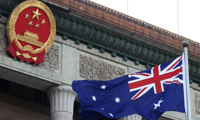 An Australian flag is seen outside the Great Hall of the People in Beijing on April 9, 2013. (Feng Li/Getty Images)
