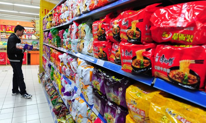 Shopping for instant noodles in China. (Frederic J. Brown/AFP/Getty Images)