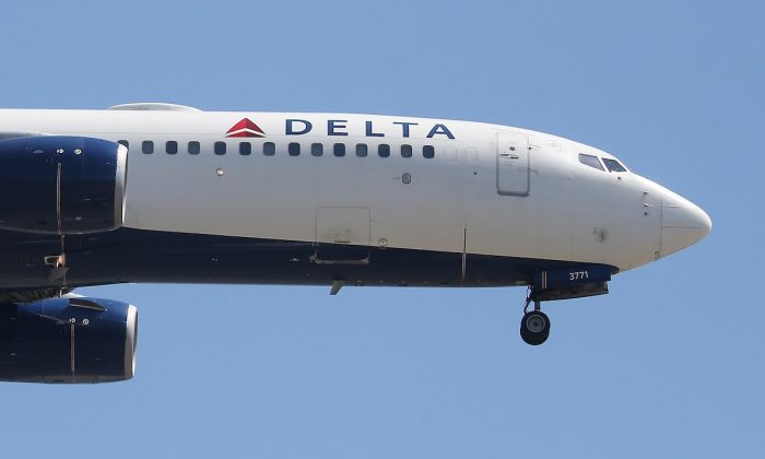 A Delta Air Lines plane lands at Los Angeles International Airport in Los Angeles, Calif., on July 12, 2018. (Mario Tama/Getty Images)
