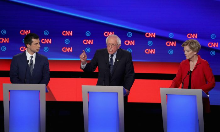 Democratic presidential candidates Sen. Bernie Sanders (D-Vt.) (C) speaks while Sen. Elizabeth Warren (D-Mass.) and South Bend, Indiana Mayor Pete Buttigieg (L) listen at the beginning of the Democratic Presidential Debate in Detroit, Michigan at the Fox Theatre on July 30, 2019. (Justin Sullivan/Getty Images)