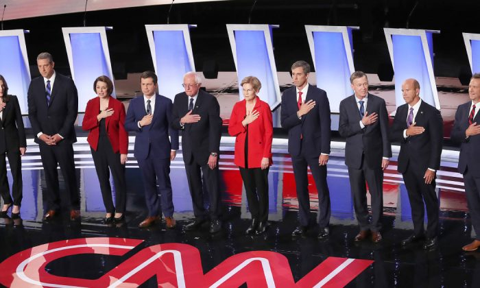 Democratic presidential candidates Marianne Williamson, (L-R), Rep. Tim Ryan (D-OH), Sen. Amy Klobuchar (D-MN), Indiana Mayor Pete Buttigieg, Sen. Bernie Sanders (I-VT), Sen. Elizabeth Warren (D-MA), former Texas congressman Beto O'Rourke, former Colorado governor John Hickenlooper, former Maryland congressman John Delaney, and Montana Gov. Steve Bullock take the stage at the beginning of the Democratic Presidential Debate at the Fox Theatre July 30, 2019 in Detroit, Michigan. 20 Democratic presidential candidates were split into two groups of 10 to take part in the debate sponsored by CNN held over two nights at Detroit's Fox Theatre. (Justin Sullivan/Getty Images)