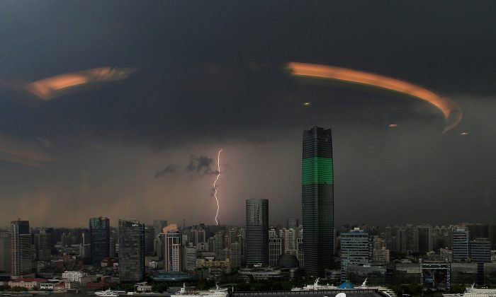 A streak of lightning is seen above the skyline of Shanghai, China on Aug. 19, 2016. (Aly Song/Reuters)