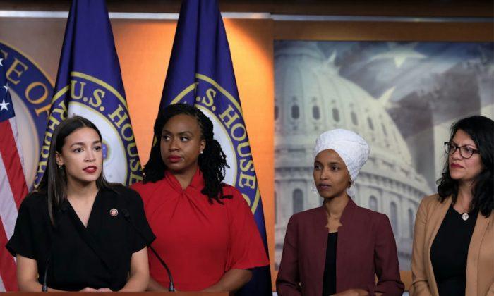 U.S. Rep. Alexandria Ocasio-Cortez (D-NY) speaks as Reps. Ayanna Pressley (D-MA), Ilhan Omar (D-MN), and Rashida Tlaib (D-MI) listen during a press conference in Washington, DC, on July 15, 2019. (Alex Wroblewski/Getty Images)