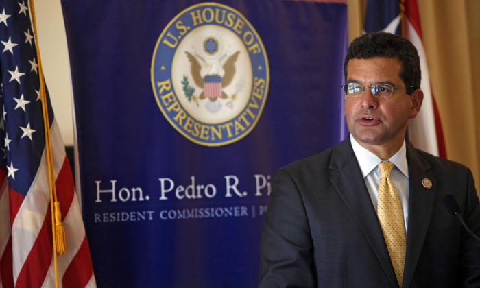 In this Sept. 24, 2013, file photo, Pedro Pierluisi, Puerto Rico's representative in the U.S. Congress, speaks during a conference in San Juan, Puerto Rico. A Puerto Rico legislator said on July 30, 2019, that the U.S. territory's embattled governor plans to nominate Pierluisi as secretary of state. (Ricardo Arduengo/AP)