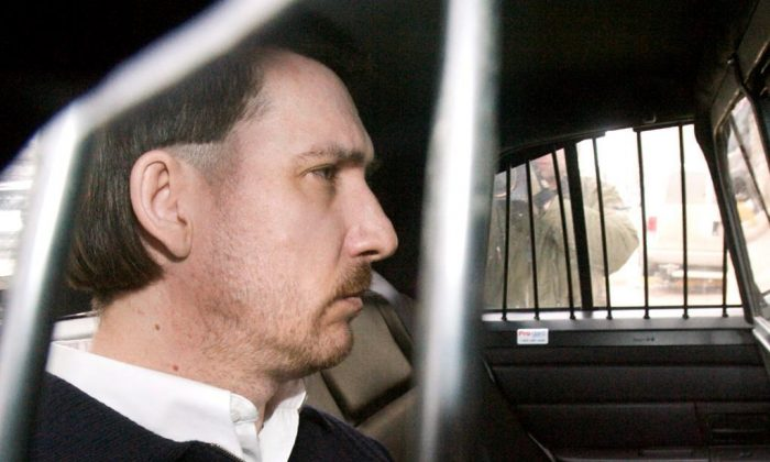 Convicted murderer Curtis Dagenais is escorted from court following sentencing in his murder trial on March 13, 2009 in Saskatoon, SK. (Geoff Howe/The Canadian Press)