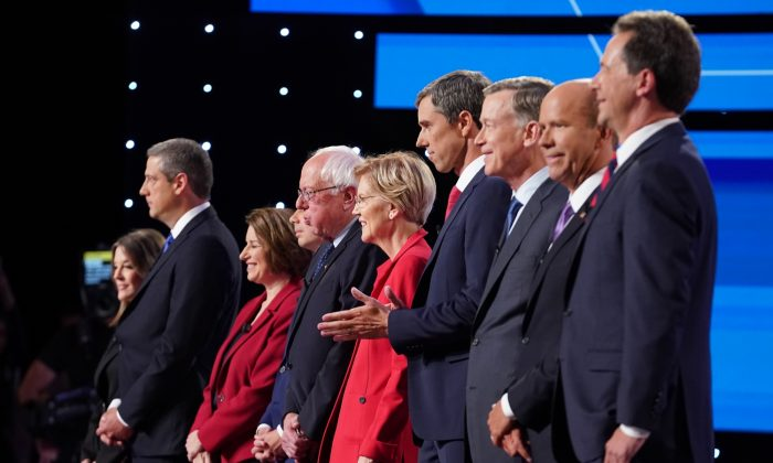 Democratic presidential candidates Marianne Williamson, (L-R), Rep. Tim Ryan (D-OH), Sen. Amy Klobuchar (D-MN), Indiana Mayor Pete Buttigieg, Sen. Bernie Sanders (I-VT), Sen. Elizabeth Warren (D-MA), former Texas congressman Beto O'Rourke, former Colorado governor John Hickenlooper, former Maryland congressman John Delaney, and Montana Gov. Steve Bullock take the stage at the beginning of the Democratic Presidential Debate at the Fox Theatre in Detroit, Michigan, on July 30, 2019. (Scott Olson/Getty Images)