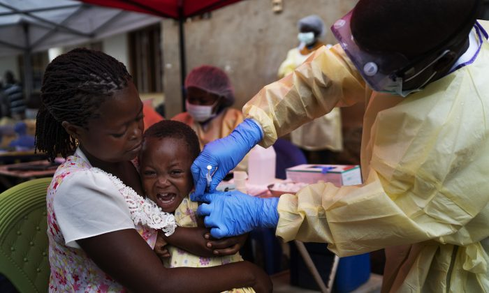 A child is vaccinated against Ebola in Beni, Congo on July 13, 2019. (Jerome Delay/AP Photo)