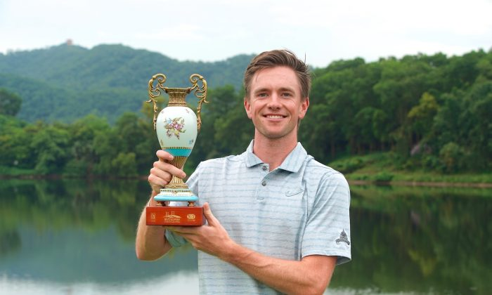 American Joey Lane displays the Donggan Open Trophy after his ten under par win at Mission Hills Norman Course last Sunday July 28. (PGA TOUR Series-China / Zhuang Liu)