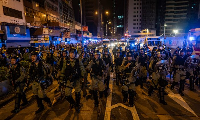 Riot police charge outside of the Mongkok Police Station during a standoff with protesters after an anti-government rally in in Hong Kong, on Sept. 1, 2019. (Anthony Kwan/Getty Images)