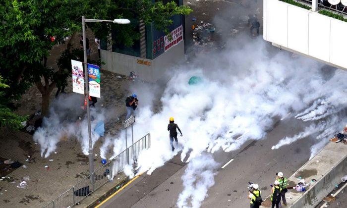 Police fire off tear gas on Tim Mei Avenue in Hong Kong on June 12, 2019. (Li Yi/The Epoch Times)