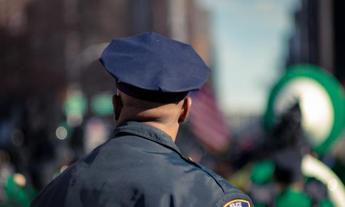 Man wearing police uniform. (Fred Mouniguet Unsplash)