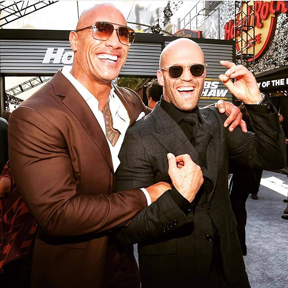 Two action stars in suits