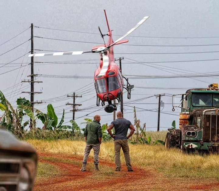 two men looking at a helicopter
