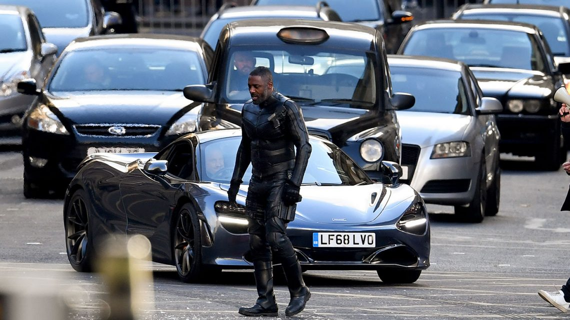 man in black leather and fast cars