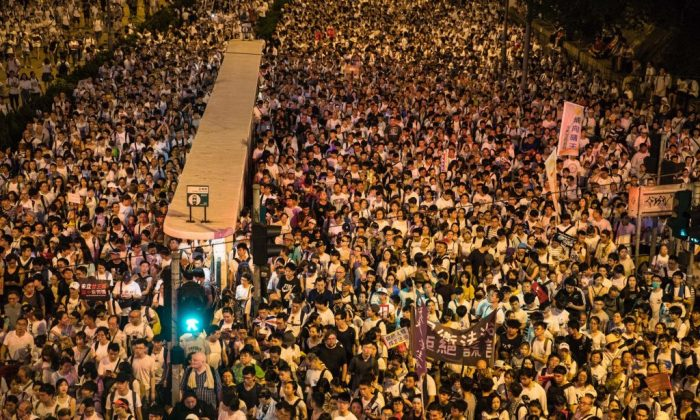 Protesters attend a rally against a controversial extradition law proposal in Hong Kong on June 9, 2019. (Dale De La Rey/AFP/Getty Images)