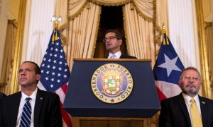 Puerto Rico Governor Resigns as Promised; Successor Sworn In