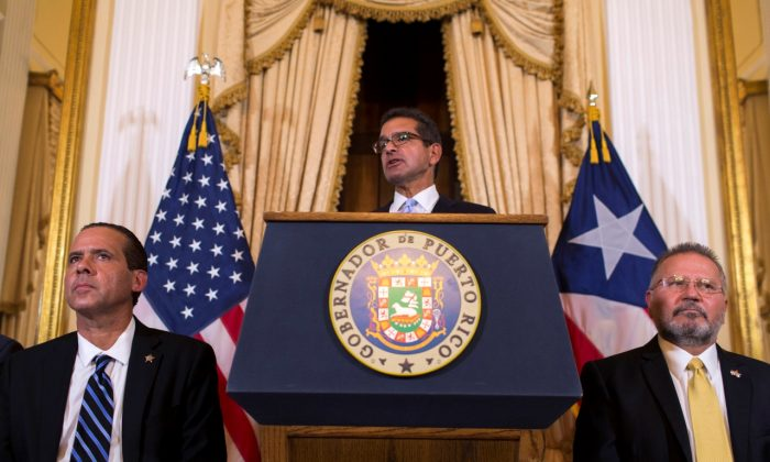 Pedro Pierluisi, sworn in as Puerto Rico's governor, speaks during a press conference, in San Juan, Puerto Rico, on Aug. 2, 2019.  (Dennis M. Rivera Pichardo/AP Photo)