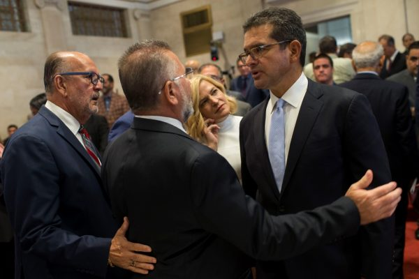 Pedro Pierluisi with lawmakers