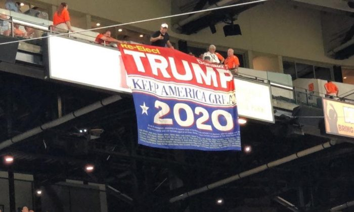 "Trump Supporters display huge re-elect Trump 2020 ""Keep America Great"" banner at the Baltimore Orioles game at Camden Yards in Baltimore, Md., on Aug. 1, 2019. (Courtesy of Dion Cini)"
