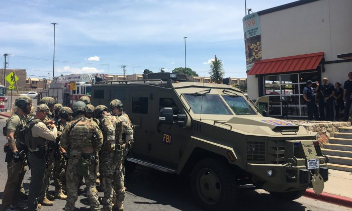 Armed police officers gather next to an FBI armored vehicle next to the Cielo Vista Mall amid an active shooter situation in El Paso on Aug. 3, 2019. (Angel Juarez/AFP/Getty Images)