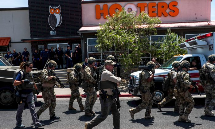 Law enforcement officers respond to an active shooter situation at a Walmart near Cielo Vista Mall in El Paso, Texas on Aug. 3, 2019. (Joel Angel Juarez/AFP/Getty Images)
