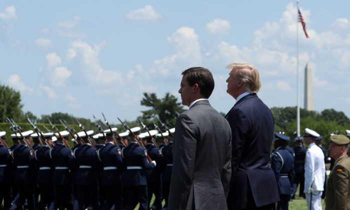 President Donald Trump (R) and Secretary of Defense Dr. Mark Esper (L) inspect the troops during a full honors welcome ceremony on the parade grounds at the Pentagon, on July 25, 2019 in Arlington, Virginia.(Mark Wilson/Getty Images)